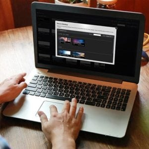 Person using the Screencast-O-Matic secure backup feature in the video editor